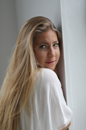 white blouse: Photo of a very attractive blonde wearing a loose fitting white blouse. Stock Photo