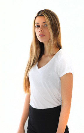 Photo of a very attractive blonde woman with beautiful brown eyes in a white top. Stok Fotoğraf