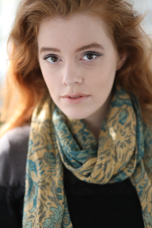 Photo of a very attractive redhead wearing a decorative blue and gold scarf. 写真素材