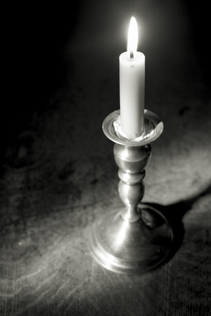 Black and white photo of a candle and candleholder. Zdjęcie Seryjne