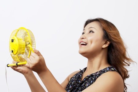 Asian woman with a fan.
