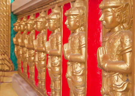 Thai statues on the temple wall  photo