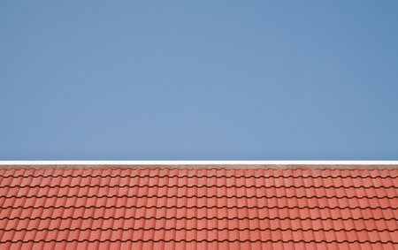 Red roof on blue sky background  photo