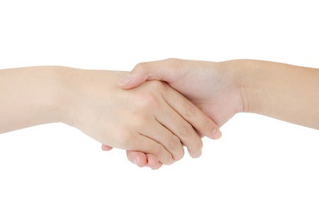 Two woman shaking hands on a white background   photo