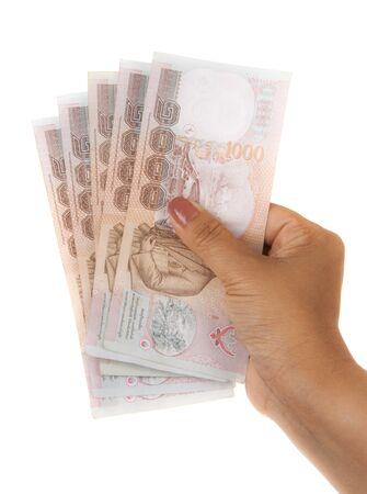 Hand holding thai money on white background