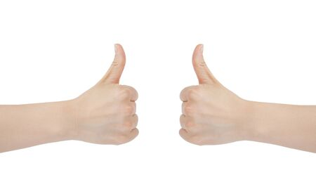 Close-up of woman holding her thumb up on white background Stock Photo - 12994468