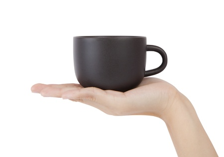 Cup in hand, isolated on white background
