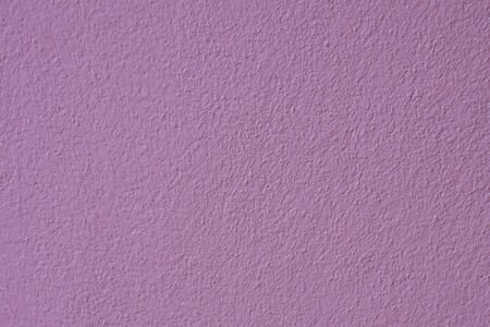 Patterned surface of the concrete walls purple  photo