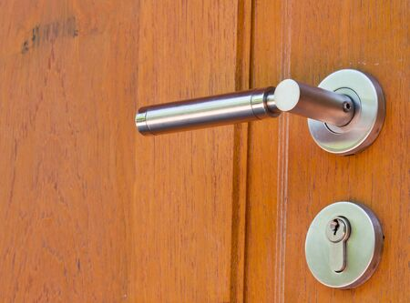 Metal lock on wooden door close up  Stock Photo - 13130723