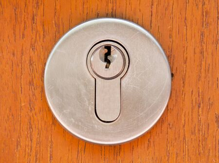 The wood door lock and stainless keyhole  Stock Photo - 13132558