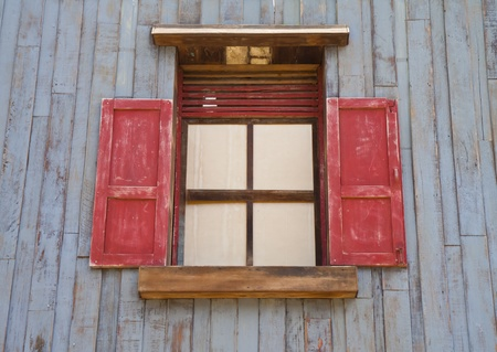 Wood windows on the walls of the old wood blue. photo
