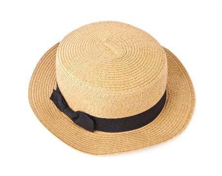 Straw hat withe black ribbon isolated on white background  photo