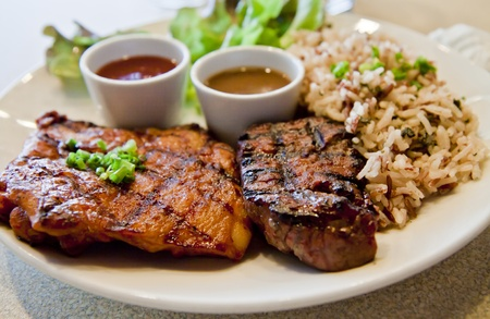 Beefsteak and chicken steak with brown rice. photo