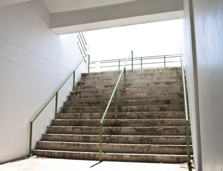 Cement stairs from the basement up to stadium.