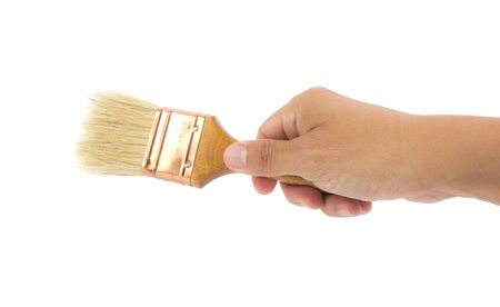 Hand holding a paint brush on white