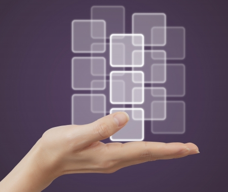 button on the palm, on light purple background Stock Photo - 15707141