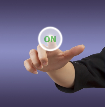 Business woman hand touch button Stock Photo - 15707111