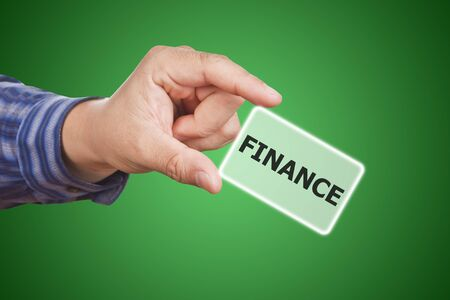 man hand touching button finance keyword, on green\ background