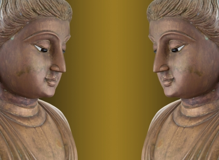 Twin buddha statues isolated on gold background  photo