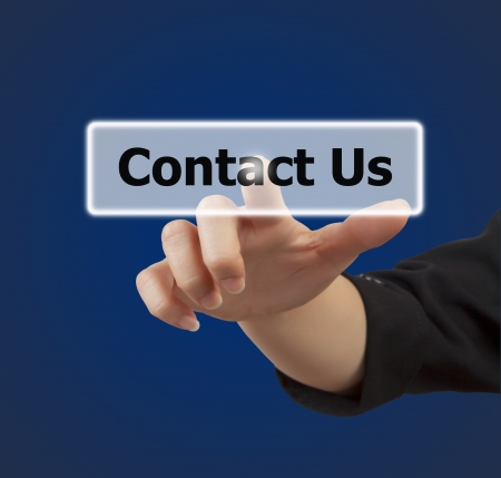 keyword: woman hand touching button contact us keyword, on blue background
