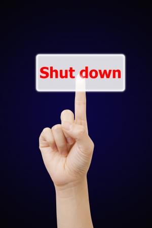 woman hand touching button shut down keyword, on gray background Stock Photo - 17127222