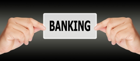 business man hand touching on banking button Stock Photo - 17185164