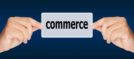 business man hand touching on commerce button Stock Photo - 17185169