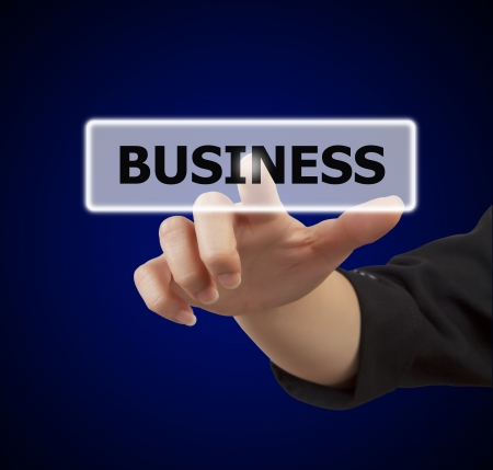 business woman hand touching on business button Stock Photo - 17330953