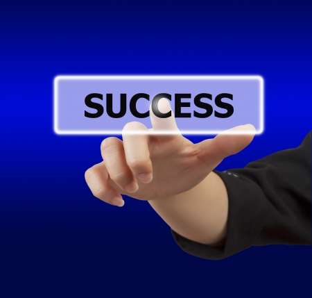 business woman hand touching on success button Stock Photo - 17346463