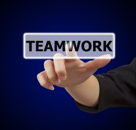 business woman hand touching on teamwork button Stock Photo - 17346464