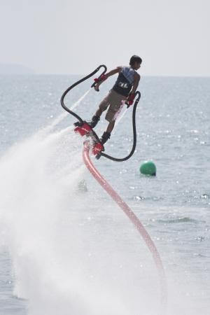 CHONBURI, THAILAND-DECEMBER 8  Unidentified man showing usage water machine flyboard in Jet Ski King Editorial
