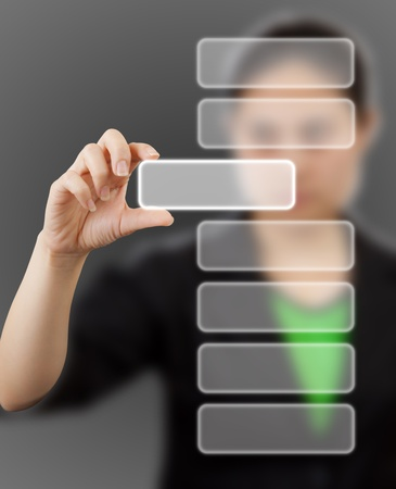 business woman touching button on gray background