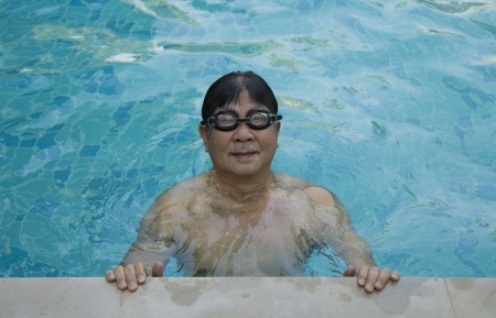 Seniors man in the pool are happy  photo