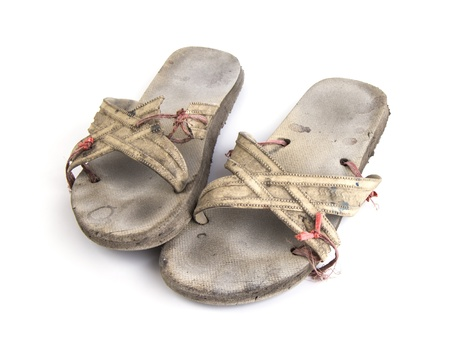 White sandals are very old, on a white background  Stock Photo
