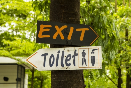 Signs to the Toilet and exit. photo
