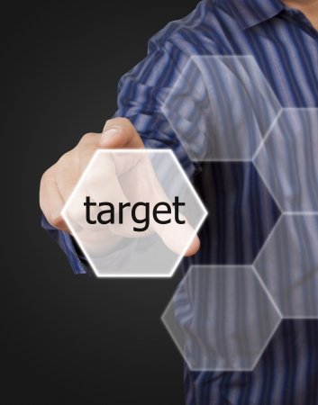 man hand touching button target keyword on gray background photo