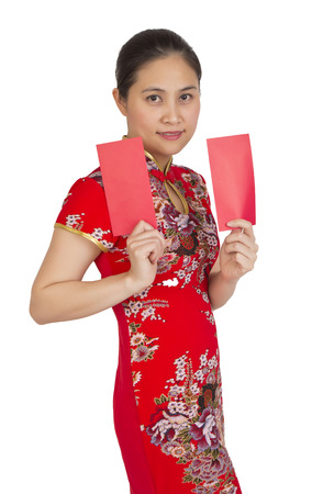 Beautiful asian woman with chinese traditional dress,  red packet is a monetary gift  Chinese new year concep on white background. photo