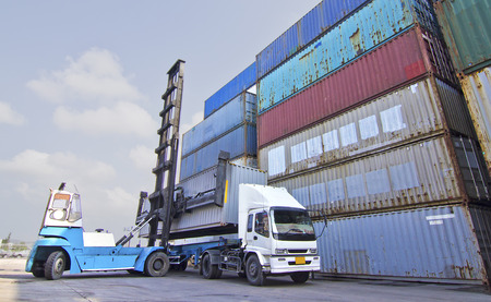 handlers: Container handlers are placing containers on trucks