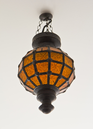 Vintage style ceiling light with decorative glass orange  photo