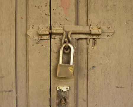 Bolt the door locked with padlock  Stock Photo - 29139114