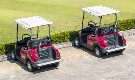 Red Golf carts on a golf course