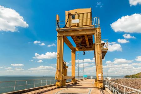 wide  wet: Large Gantry Crane on Blue Sky at Ubonrat Dam, khonkaen, Thailand