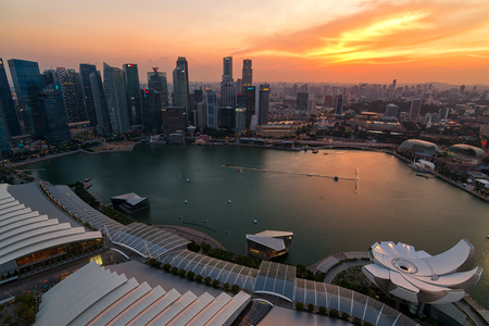 june 25: SINGAPORE - JUNE 25, 2015 : Singapore City Skyline and view of skyscrapers on Marina Bay at twilight on June 25, 2015 in Singapore.