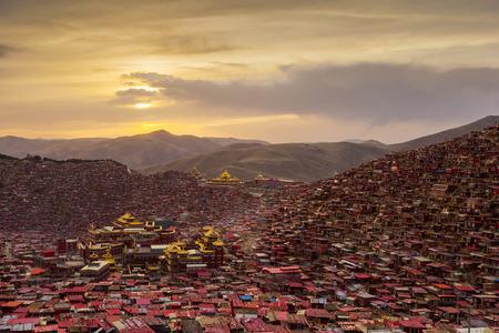 Monastery at Larung gar (Buddhist Academy) in sunset, Sichuan, China.