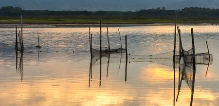 Fishing nets in the swamps at sunrise, chonburi, Thailand Stock Photo