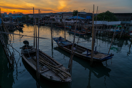 Fishing boat at fisherman village with sunset Stock Photo