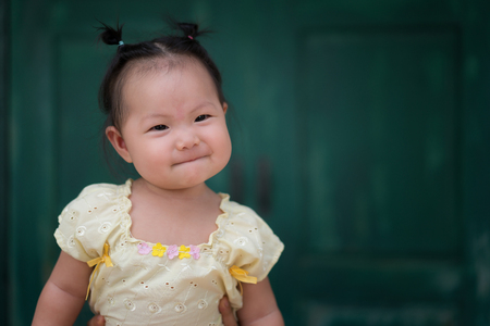 Happy Asian baby girl with Thai traditional dress.