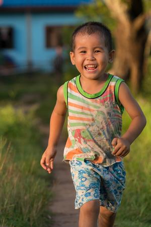 CHAMPASAK, LAOS, SEPTEMBER 23 : Portrait of unidentified Laos little boy are running happily on September 23, 2015