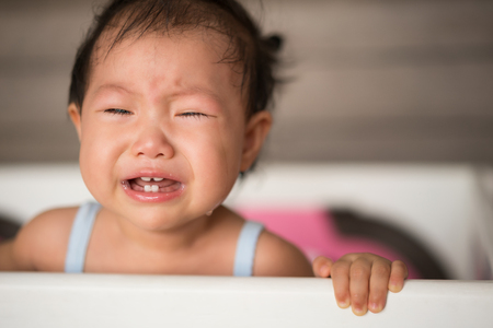 portrait of a crying  asian baby girl