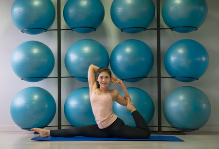 Asian young woman yoga pose in studio